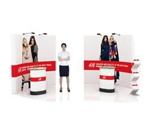 鹰牌展架为H·M服装制作新品推广、会议活动解决方案